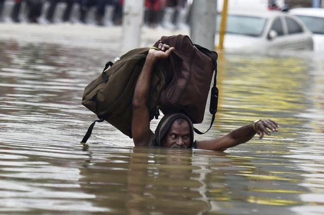 chennai rains made a man to leave his house and shelter to a safer place